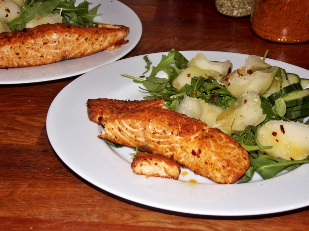 Grilled salmon - plated with melon and cucumber salad