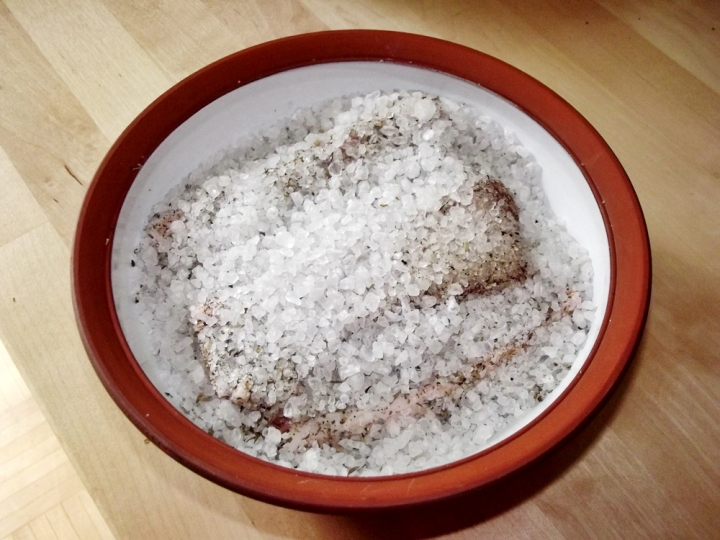 Bowl with salt and curing fat, before being covered and placed in the refrigerator.