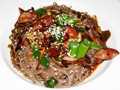 Fusion food: 100% buckwheat soba noodles in a soy-balsamic-sesame oil dressing, with smoked Odessa sausage and funnel chanterelles, finished with toasted sesame seeds.